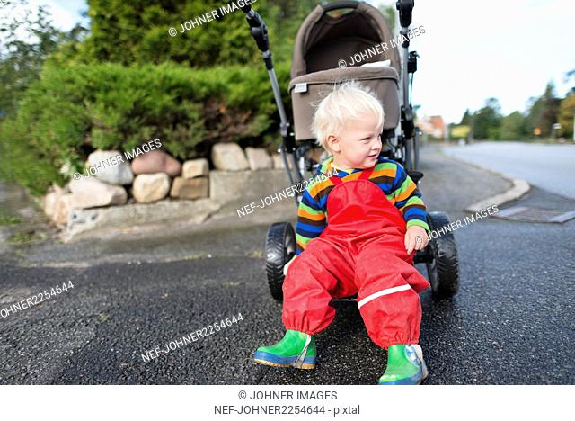 Boy sitting on pram