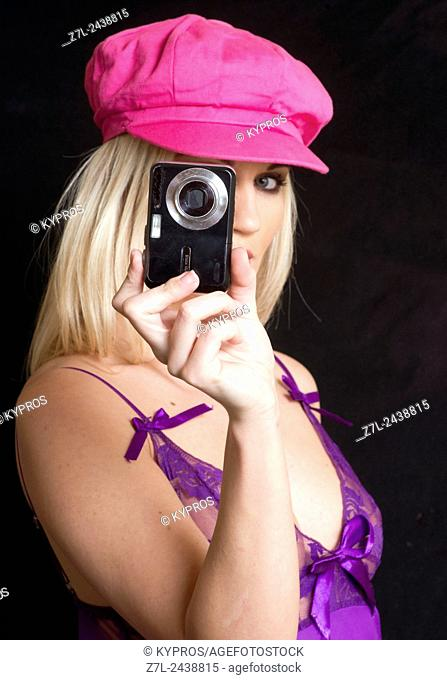 Young Woman Taking Pictures With A Digital Camera
