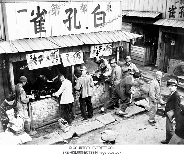 Food stall in post-World War II Tokyo has customers, but no rice. As late as the mid-1950's, Japan's economy was still recovering from defeat