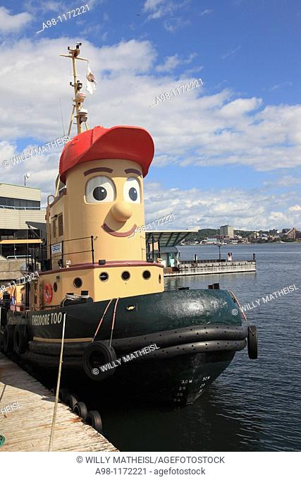 Harbour Walk on waterfront with moored large-scale imitation tugboat and face called 'Theodore Too' in Halifax, Nova Scotia, Canada, North America