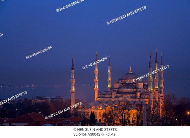Blue Mosque at dusk with Bosphorus in background, Istanbul, Turkey
