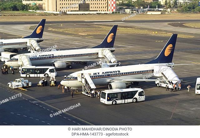 Passengers coming out from Jet Airways Aircrafts parked at CST airport ; Santacruz ; Bombay now Mumbai ; Maharashtra ; India
