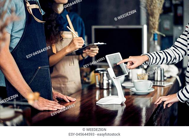 customer self service order drink menu with tablet screen at cafe counter bar,seller coffee shop accept payment by mobile.digital lifestyle concept