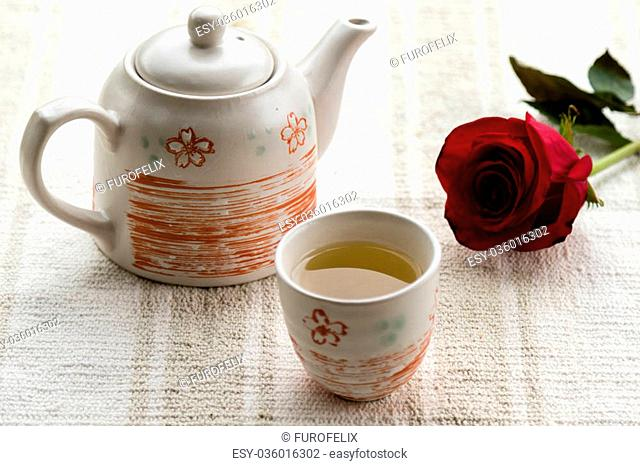 fresh healthy hot tea in a teapot and cup whit rose