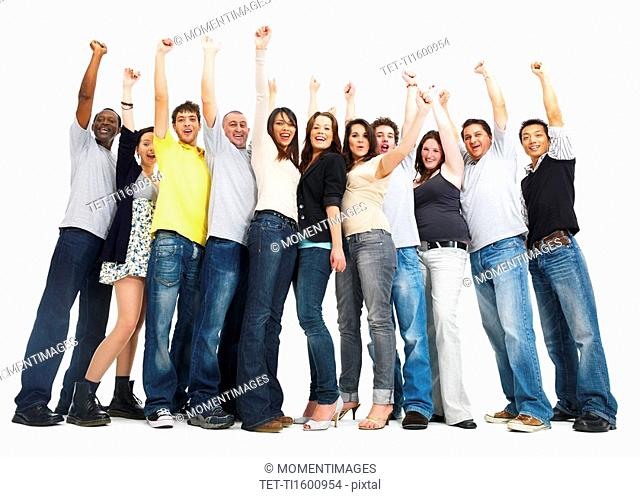 Group of people raising their arms