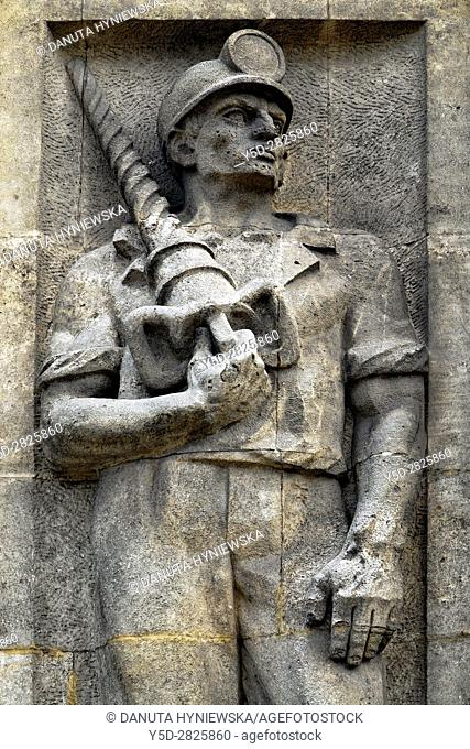 Reminders of communist era, reliefs of heroic workers. here heroic miner, Marszalkowska street in Warsaw. Poland