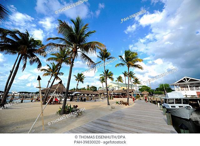 Tourists relax at a beach esplanade at Florida Keys in Islamorada, Florida, USA, 26 May 2013.Photo: Thomas Eisenhuth | usage worldwide