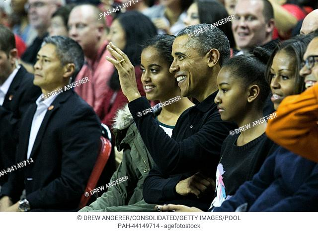 (L-R): daughter Malia Obama, United States President Barack Obama, Sasha Obama and First Lady Michelle Obama attend the men's NCAA basketball match between...