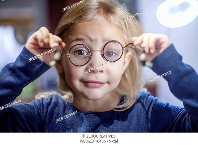 Little girl looking through spectacles
