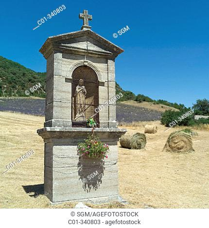 Shrine and wheat straw bales. Vaucluse. Provence. France