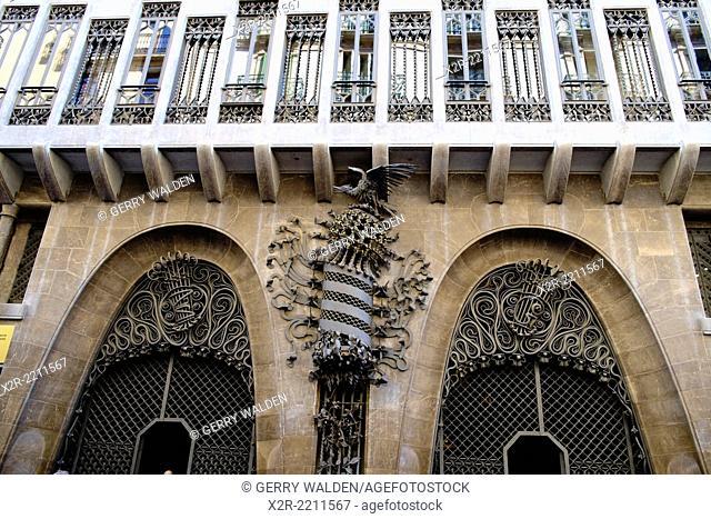 The exterior facia of the Gaudi-designed Palau Guell on Carrer nou de la Rambla, Barcelona, Spain