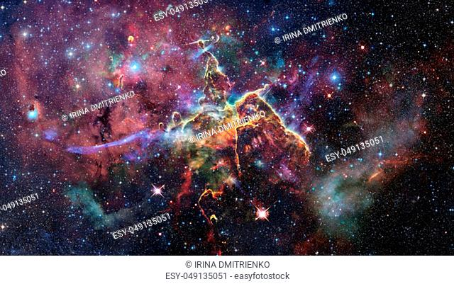 Mystic Mountain. Region in the Carina Nebula imaged by the Hubble Space Telescope. Elements of this image furnished by NASA