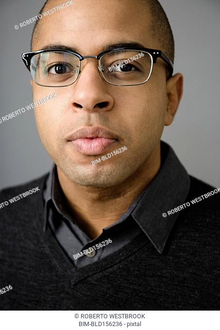 Close up of mixed race man wearing eyeglasses