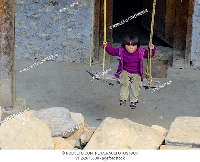 Girl swinging in Bhutan
