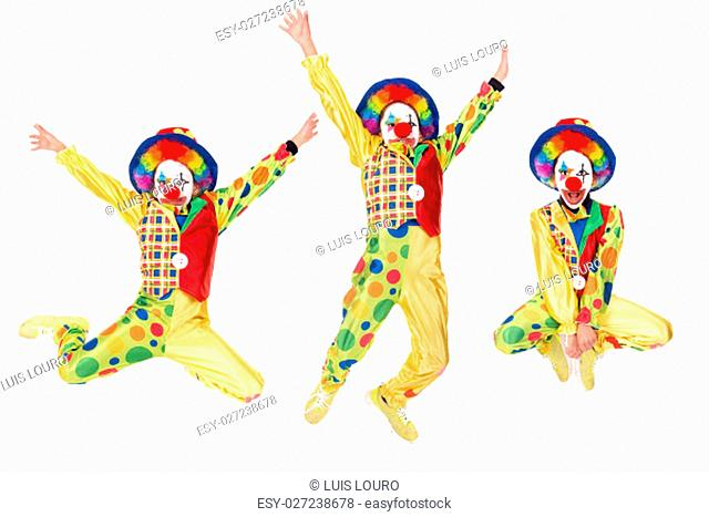 Young girl with clown costume jumping isolated in white