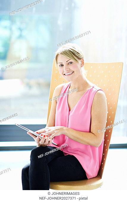 Young businesswoman using tablet