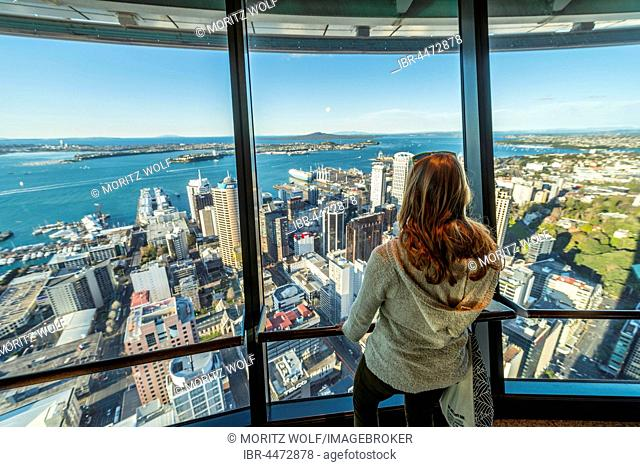 Tourist enjoying the view from the observation deck of the Sky Tower, skyline with skyscrapers, Central Business District, Auckland Region, North Island