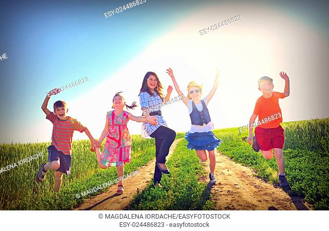 happy children play on field in summer time