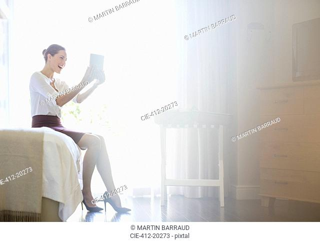 Businesswoman using digital tablet in hotel room