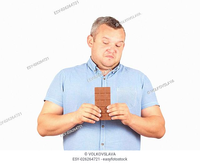 fat man refuses to chocolate. Diet, overweight, healthy food Isolated on white background