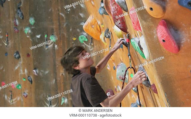 boy on an indoor climbing wall