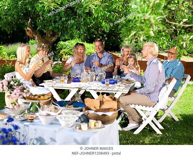 Family having party in garden