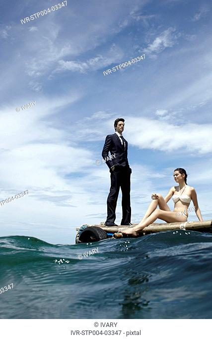 A young couple posing on a dock