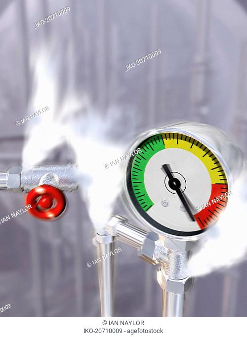 Steam pressure escaping from pipes with pressure gauge warning
