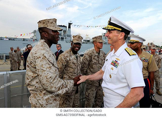 Chief of Naval Operations CNO Admiral Jonathan Greenert shakes hands and meets with Marines at the USO New York City Fleet Week block party, New York, 2012