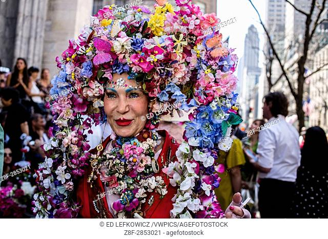 New York, NY - April 16, 2017. A woman wears an elaborate arched headpiece covered with hundreds of flowers at New York's annual Easter Bonnet Parade and...