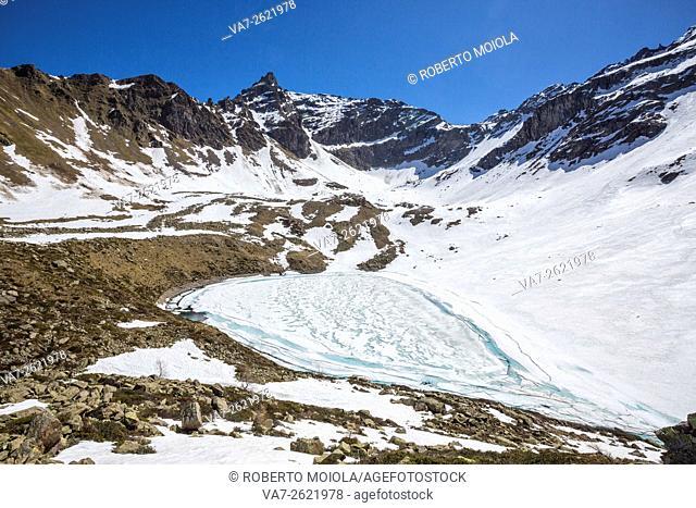 The snow begins to melt due to the spring thaw at Laj dal Teo Poschiavo Valley Canton of Graubunden Switzerland Europe