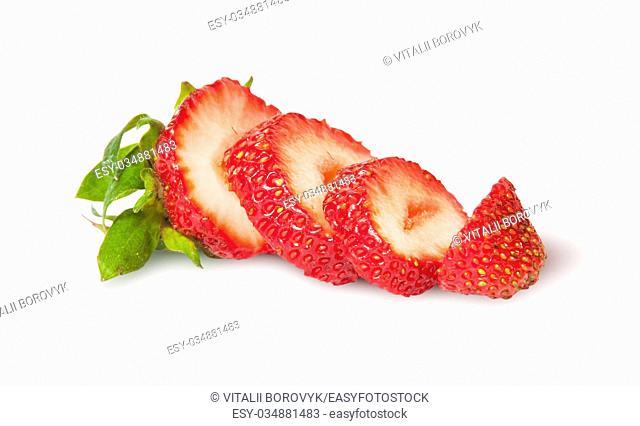 Sliced fresh juicy strawberries rotated isolated on white background