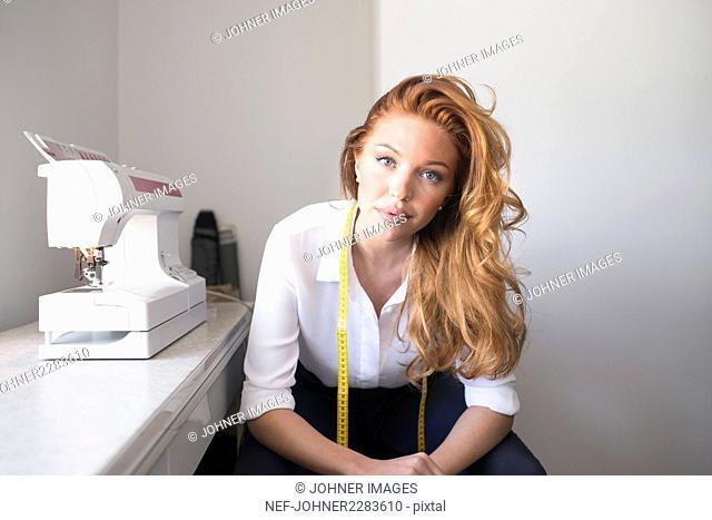 Portrait of woman in textile workshop