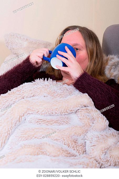 Woman is sick and drinks tea