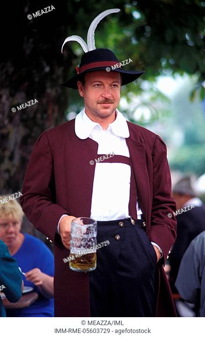 Ruhpolding, folklore festival, man holding a glass of beer , Bavaria, Germany, Europe