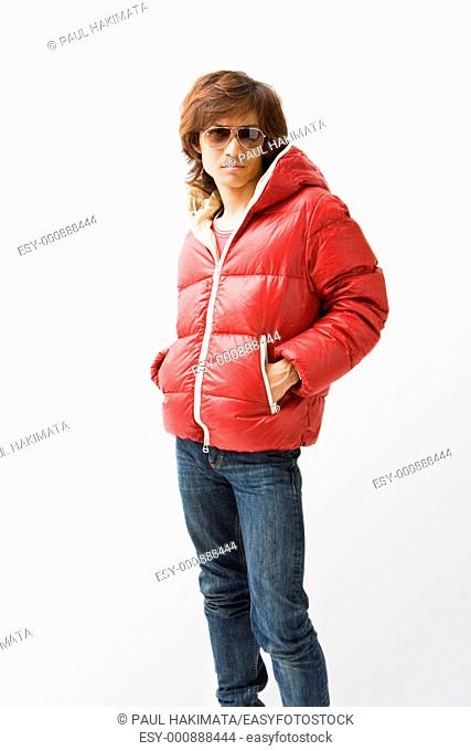Cool Asian guy wearing a red winter coat and sunglasses, isolated