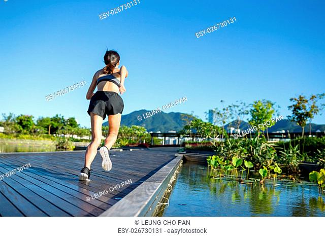 Woman running in outdoor park
