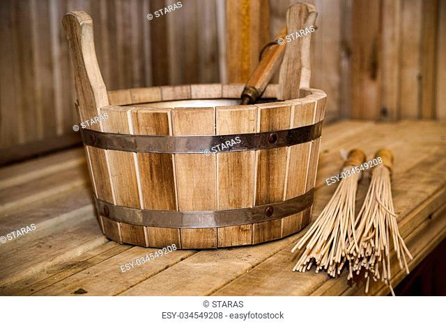 Sauna, bath accessories. Wooden bucket and sticks