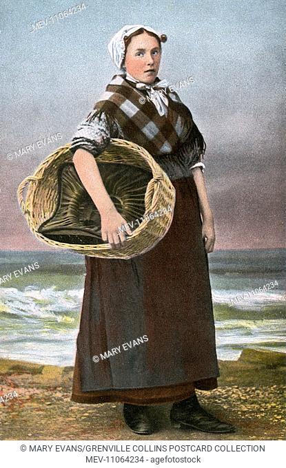 Scheveningen, The Netherlands: Fishwife holding a basket on the beach