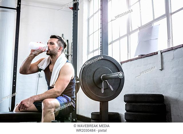 Fit man drinking a protein shake