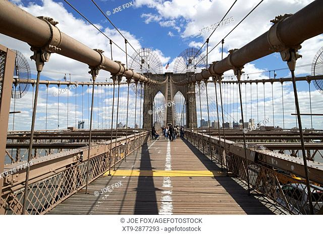 walking across the brooklyn bridge New York City USA