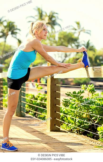 Attractive fit young woman stretching before exercise workout, Healthy lifestyle sports fitness concept