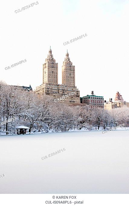 View of The San Remo building from Central Park lake in winter, Manhattan, New York City, USA