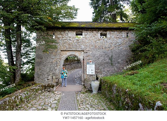 Woman leaving Bled Castle through a gate, Slovenia