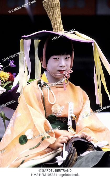Japan, Honshu Island, Kyoto, a young boy appearing during the Gion Matsuri festival