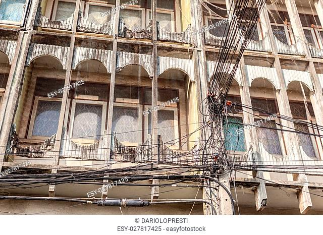 Tangled and messy electrical cables in Bangkok city
