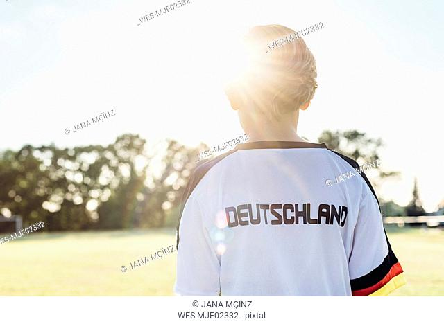 Boy wearing football shirt with Germany written on back