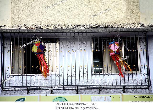 Indian Deepawali diwali festival ; lanterns hanging in balcony of home ; Mumbai Bombay ; Maharashtra ; India