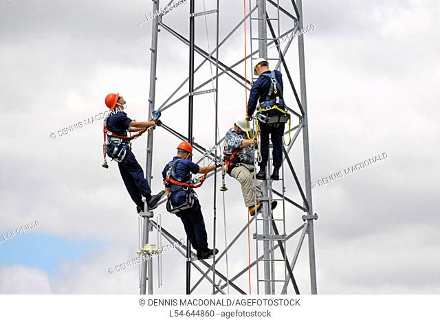 Kenosha Wisconsin based Coast Guard practice climbing technique on a tower during a training session
