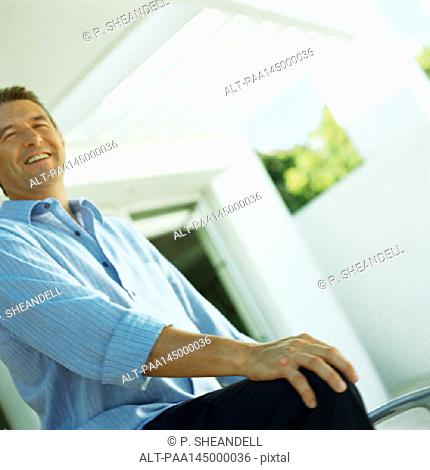 Mature man smiling, low angle view